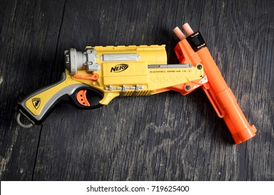 London, England - May 05, 2014: Nerf Dart Gun and Foam Bullets, Nerf was founded in 1969 and is currently owned by Hasbro.