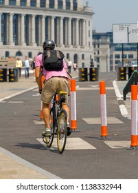 London, England - May 05, 2018: Cyclist using the New TFL Cycle Superhighway in London