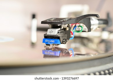 LONDON, ENGLAND - MAY 08, 2019: Audiophile cartridge Shure 97 mounted in Technics shell with reflection in mirror surface. Vinyl records equipment, macro, close-up