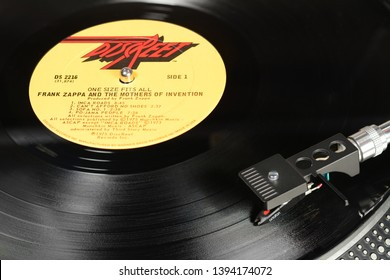 LONDON, ENGLAND - MAY 08, 2019: Vintage vinyl record with Discreet label played on the turntable with audiophile Ortofon cartridge.