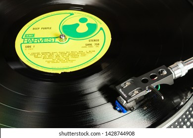 LONDON, ENGLAND - MAY 08, 2019: Vintage vinyl record with EMI Harvest label played on Technics turntable with audiophile Shure cartridge.
