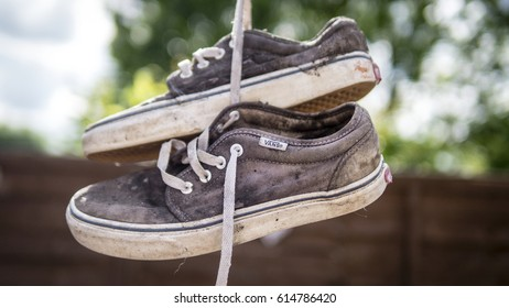 London, England - May 09, 2014: Pair of well worn Vans Skateboarding Trainers, Vans is an American manufacturer of shoes and founded in 1966.