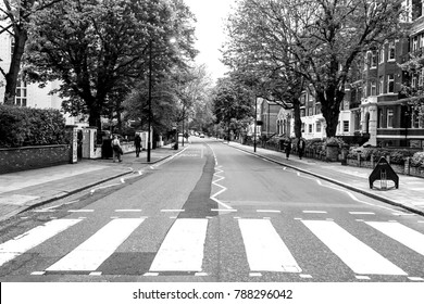 LONDON, ENGLAND - MAY 10, 2012 : The famous scenery of zebra crossing at Abbey Road made famous by the 1969 Beatles album cover. Black and white color.