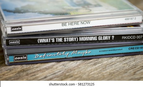 London, England - May 10, 2014 British rock band Oasis first 3 albums launched in the 1990's, Definitely Maybe - 1994, What's The story Morning Glory - 1995, Be Here Now - 1997 on Compact Disc