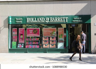 London, England, May 11th 2018: People walking past Holland & Barrett store in City of London