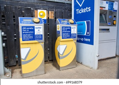 LONDON, ENGLAND - MAY 13, 2017 : Oyster terminals in London. Oyster is a plastic smartcard which can hold pay as you go credit, Travelcards and Bus and Tram Passes.