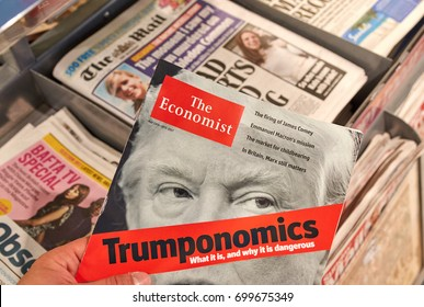 LONDON, ENGLAND - MAY 14, 2017 : The Economist magazine with Donald Trump on title page. The Economist is an English-language weekly magazine-format newspaper owned by the Economist Group.
