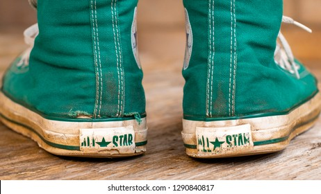 London, England - May 17, 2014: Pair of Converse Baseball Boots in worn condition, Converse is an American shoe company founded in 1908
