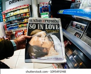 LONDON, ENGLAND - MAY 20, 2018: POV The Sunday Express front cover newspaper in British press kiosk featuring portraits of Prince Harry and Meghan Markle following the Royal Wedding So In Love