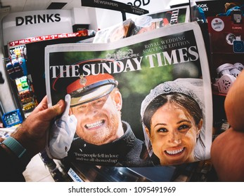 LONDON, ENGLAND - MAY 20, 2018: POV The Sunday Times front cover newspaper in British press kiosk featuring portraits of Prince Harry and Meghan Markle following the Royal Wedding lifestyle event