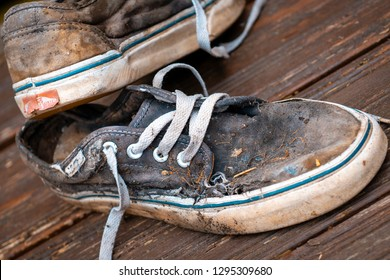 London, England - May 23, 2014: Well worn pair of Vans skateboarding trainers, Vans is based in Santa Ana, California and founded in 1966