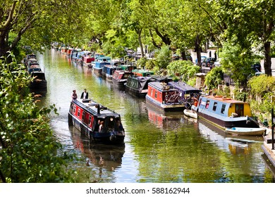 London, England. May 25, 2014. Tourists strolling by boat in Little Venice, Regent's Canal, London, England