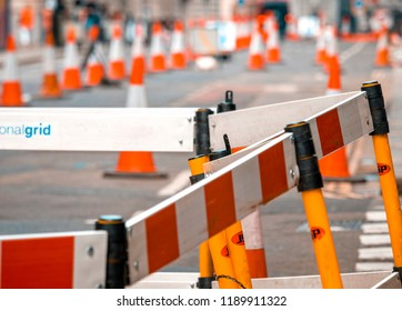London, England - May 27, 2018: Road works on busy London street due to carriageway repairs.