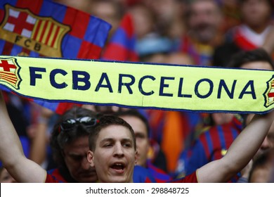 LONDON, ENGLAND. May 28 2011: A fan with a Barcelona scarf during the 2011UEFA Champions League final between Manchester United and FC Barcelona, at Wembley Stadium
