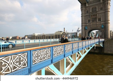 LONDON, ENGLAND, MAY 28, 2016  Tourist and cars cross over the River Thames by using the iconic blue and white Tower Bridge.