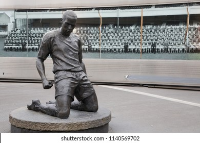 London, England - MAY 4: View of Thierry Henry Bronze Statue in Front of Arsenal Emirates Stadium in London on May 4, 2017.