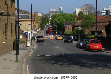 London, England - May 6, 2018: Police cordon off a block of Silverthorne Road at the crime scene of a stabbing.