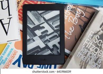 LONDON , ENGLAND - MAY 6: Amazon Kindle e-book reader on the pile of books on May 6,2017
