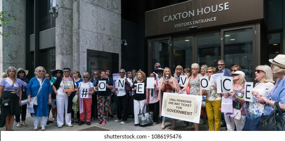 London / England - May 8 2018: Group of women born in the 1950s protest outside the Department of Work and Pensions. WASPI, One Voice. Back to 60 campaign for pension rights.