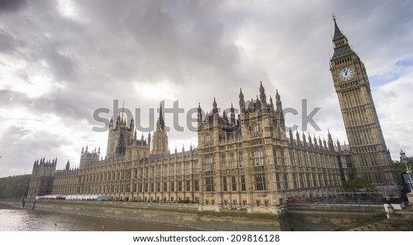 London, England - NOV 6: The Palace of Westminsterin London, England on November 6 2013. It is the meeting place of the House of Commons and the House of Lords, the two houses of the Parliament of UK.