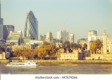 LONDON, ENGLAND - NOVEMBER 01, 2015. The City in a bright sunny day at sunset while walking people look with expectation. This district is the the European Union's financial and trade center.
