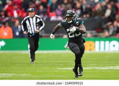 LONDON, ENGLAND - NOVEMBER 03 2019: Jacksonville Jaguars running back, Ryquell Armstead (23) runs with the ball during the NFL game between Houston Texans and Jacksonville Jaguars at Wembley Stadium