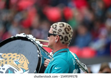 LONDON, ENGLAND - NOVEMBER 03 2019: A Jaguars band member with his hair dyed during the NFL game between Houston Texans and Jacksonville Jaguars at Wembley Stadium