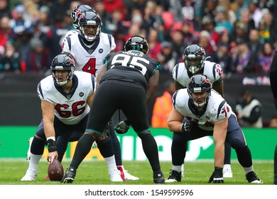 LONDON, ENGLAND - NOVEMBER 03 2019: Houston Texan's center, Nick Martin (66) and quarterback, Deshaun Watson (4) during the NFL game between Houston Texans and Jacksonville Jaguars at Wembley Stadium