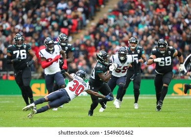 LONDON, ENGLAND - NOVEMBER 03 2019: Houston Texan's cornerback, Derrick Baity Jr. (30) tackling Jacksonville Jaguars running back, Ryquell Armstead (23) during the NFL game