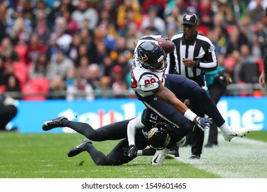LONDON, ENGLAND - NOVEMBER 03 2019: Jacksonville Jaguars cornerback, Breon Borders (31) tackling Houston Texan's tight end, Jordan Akins (88) during the NFL game