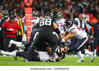 LONDON, ENGLAND - NOVEMBER 03 2019: Jacksonville Jaguars quarterback, Gardner Minshew (15) is tackled by Houston Texan's outside linebacker, Dylan Cole (51) during the NFL game