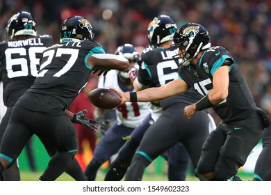 LONDON, ENGLAND - NOVEMBER 03 2019: Jacksonville Jaguars quarterback, Gardner Minshew (15) hands off to running back, Leonard Fournette (27) during the NFL game