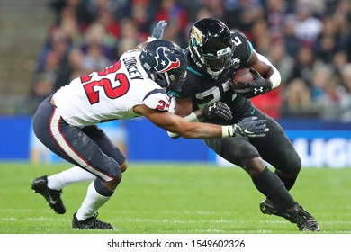 LONDON, ENGLAND - NOVEMBER 03 2019: Houston Texan's cornerback, Gareon Conley (22) tackling Jacksonville Jaguars running back, Leonard Fournette (27) during the NFL game