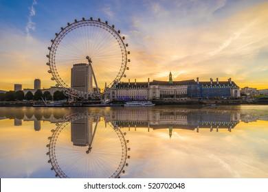 LONDON, ENGLAND - NOVEMBER, 2015. The London Eye with water reflection at sunrise
