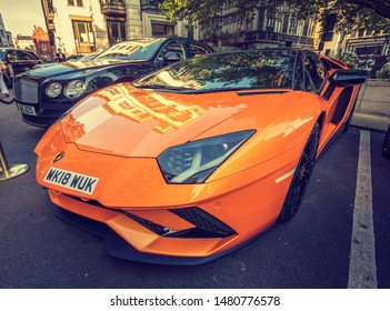 London, England - November 2017: Lamborghini Aventador LP750-4 SV parked by a luxury hotel in central London Mayfair area. Only 600 of these sports cars were made