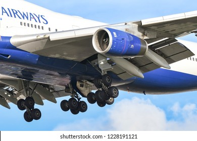 "LONDON, ENGLAND - NOVEMBER 2018: Close up view of the engines, wheels and flaps of a Boeing 747 ""Jumbo jet"" as it comes in to land at London Heathrow Airport."