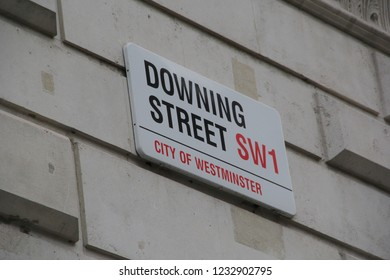 London, England - November 2018: Downing Street in the City of Westminster, London. Number 10 Downing Street is office of British Prime Minister, dealing with BREXIT. Street sign at the UK government