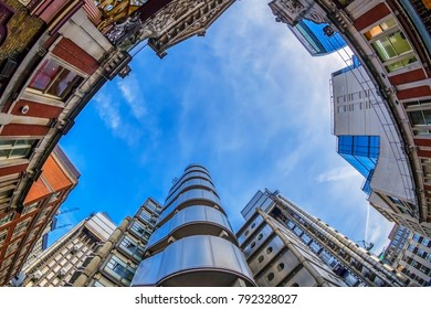 LONDON, ENGLAND - NOVEMBER 27, 2017: New and old together. Wide angle shot with new Lloyd's Building (also known as The Inside-Out Building) and old buildings from Leadenhall market.