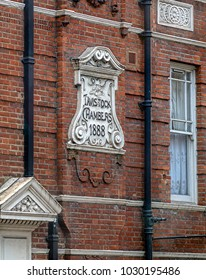 LONDON, ENGLAND - NOVEMBER 28, 2017: Facade and inscription of historical building in London on victorian architecture, with Tavistock & District Chamber of Commerce dated from 1888.