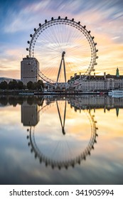 LONDON, ENGLAND - NOVEMBER 8,2015 : The London Eye on the South Bank of the River Thames at  sunrise  in London, England. Vertical composition.