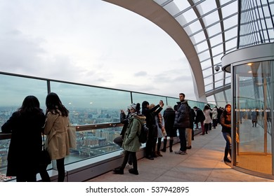 London, England - November,23.2016 - People enjoying the view from the panoramic terrace of Sky Garden