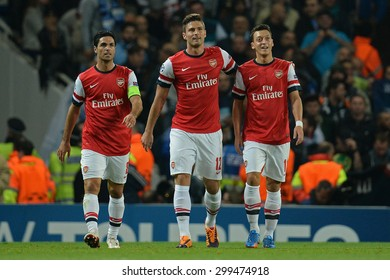 LONDON, ENGLAND - Oct 01 2013: Arsenal's  Olivier Giroud from France  and Arsenal's  Mesut Ozil from Germany  celebrate a goal during the UEFA Champions League match between Arsenal and Napoli.