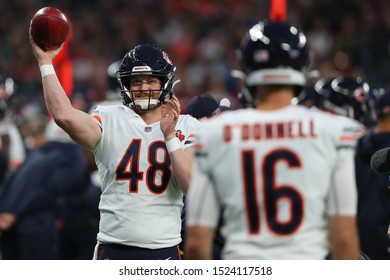 LONDON, ENGLAND - OCTOBER 06 2019: Long snapper Patrick Scales of The Chicago Bears and Punter Pat O'Donnell during the NFL game between Chicago Bears and Oakland Raiders