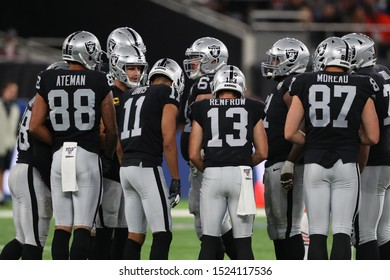 LONDON, ENGLAND - OCTOBER 06 2019: Quarterback Derek Carr of The Oakland Raiders talks with the team during the NFL game between Chicago Bears and Oakland Raiders