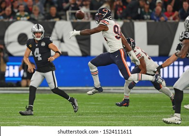 LONDON, ENGLAND - OCTOBER 06 2019:Quarterback Derek Carr of The Oakland Raiders  during the NFL game between Chicago Bears and Oakland Raiders at Tottenham Stadium in London, United Kingdom.