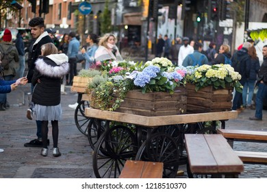 LONDON, ENGLAND - October 12, 2018 Cart with hydrangeas in the middle of Camden Town