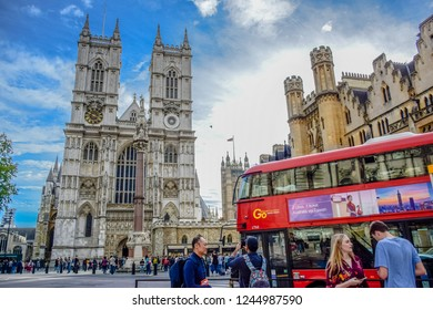 LONDON, ENGLAND - OCTOBER 14: Road in front of Westminster Abbey full of cars, buses and tourists in the city of Westminster, London, England, United Kingdom