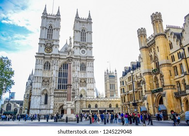 LONDON, ENGLAND - OCTOBER 14: Tourists visiting Westminster Abbey, a gothic abbey church at the west of the Palace of Westminster in London, England, United Kingdom