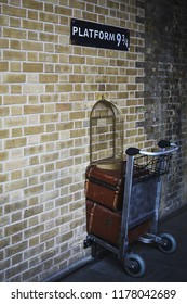 LONDON, ENGLAND - OCTOBER 15, 2013: Luggage trolley on Platform 9 3/4 at King's cross station in London, England
