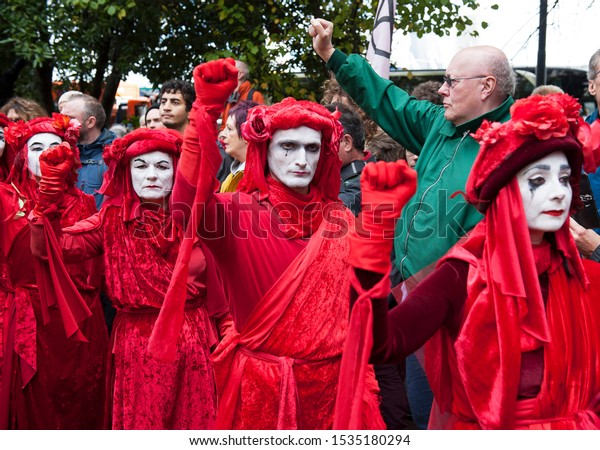 London, England. October 18th, 2019. Extinction Rebellion lead a Red Handed protest around Whitehall, attempting to leave red hand prints on government buildings.
